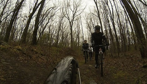 "A view of Ed from the back of Carolyn Johnson's (Firefly) bike during Ride Studio Cafe's 2014 ""Diverged"" trail ride"